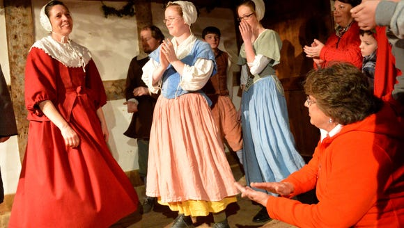 Historical interpreters on the English farm dance a