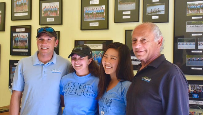 Zoe Rose and Ashley Lim signed to row in college for North Carolina last week. Pictured here from left to right are Asheville Youth Rowing Association assistant coach Rudy Ryback, Rose, Lim and AYRA head coach Jack Gartner.