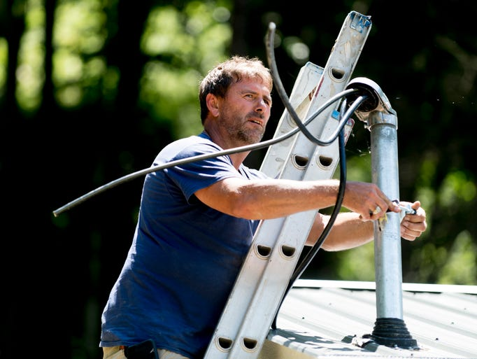 Scott Odom, of Halls Electric, works on a utility pole