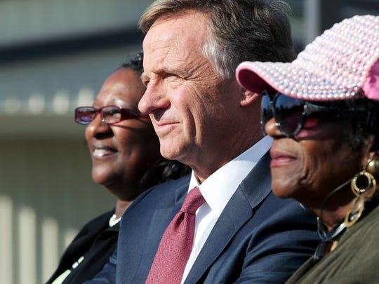 November 9, 2015 - Tennessee Governor Bill Haslam sits between State Representatives Karen Camper (left, District 87) and Barbara Cooper (District 86, right) during a press conference at the Memphis Intermodal Facility located at 4814 Lamar Ave. Monday. Gov. Haslam was in Memphis advocating for a way to fund highway improvements. (Yalonda M. James/The Commercial Appeal)