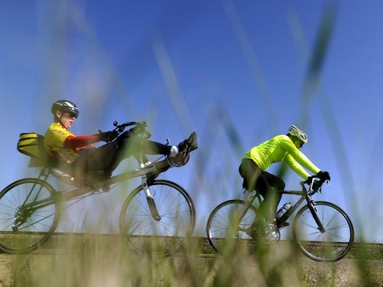 Thomas Metthe/Reporter-News A pair of cyclists cruise down FM 18 east of Abilene during the Steam-N-Wheels bike race on Saturday, March 19, 2016.