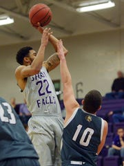 USF's Jared Mayes takes a shot over Southwest Minnesota State's Shaun Condon on Dec. 8. Mayes starred at Rock Valley College.