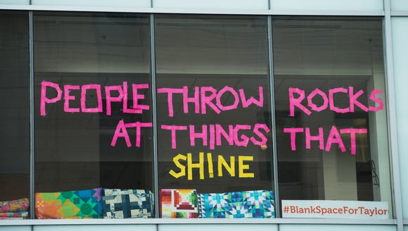 A message displaying lyrics from the Taylor Swift song