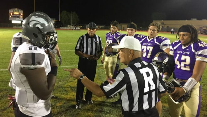 Marana Mountain View and Queen Creek meet at midfield for the pre-game coin toss on Friday, Nov. 3, 2017.