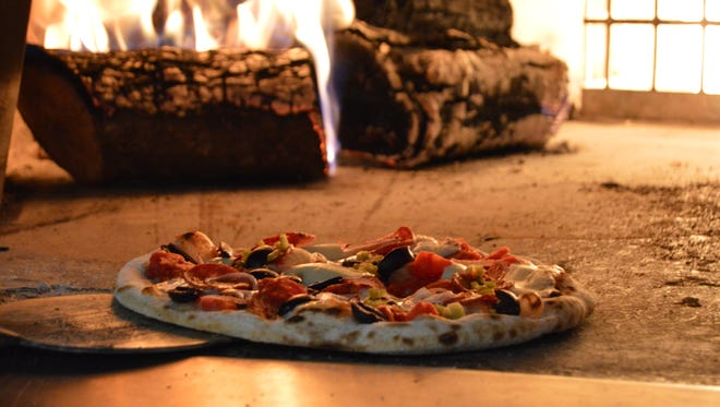 A pizza bubbles Feb. 18 at Siculi Rustic Italian Kitchen. The restaurant's brick oven cooks pies in under five minutes.