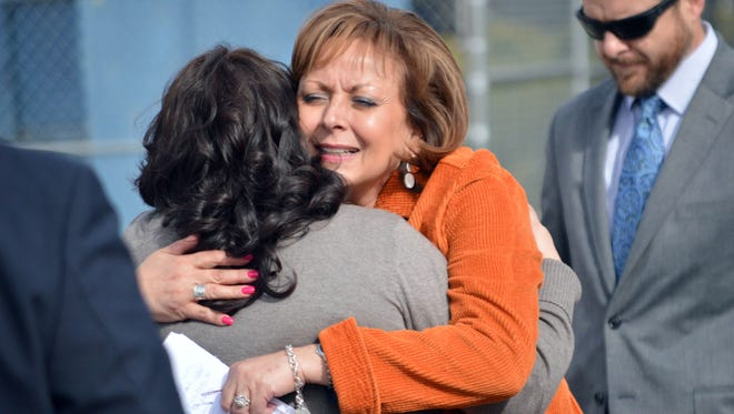 New Mexico Gov. Susana Martinez, center, hugs a family member of a victim of a drunken driving accident, during a press conference in Albuquerque on Tuesday, March 1, 2016. The Republican governor signed a bill Tuesday aimed at strengthening some drunken driving penalties. The bill makes it a second-degree felony to be convicted of eight or more DWIs, meaning tougher sentencing guidelines would be imposed. The measure also substantially increases penalties for convicted drunk drivers involved in fatal crashes.