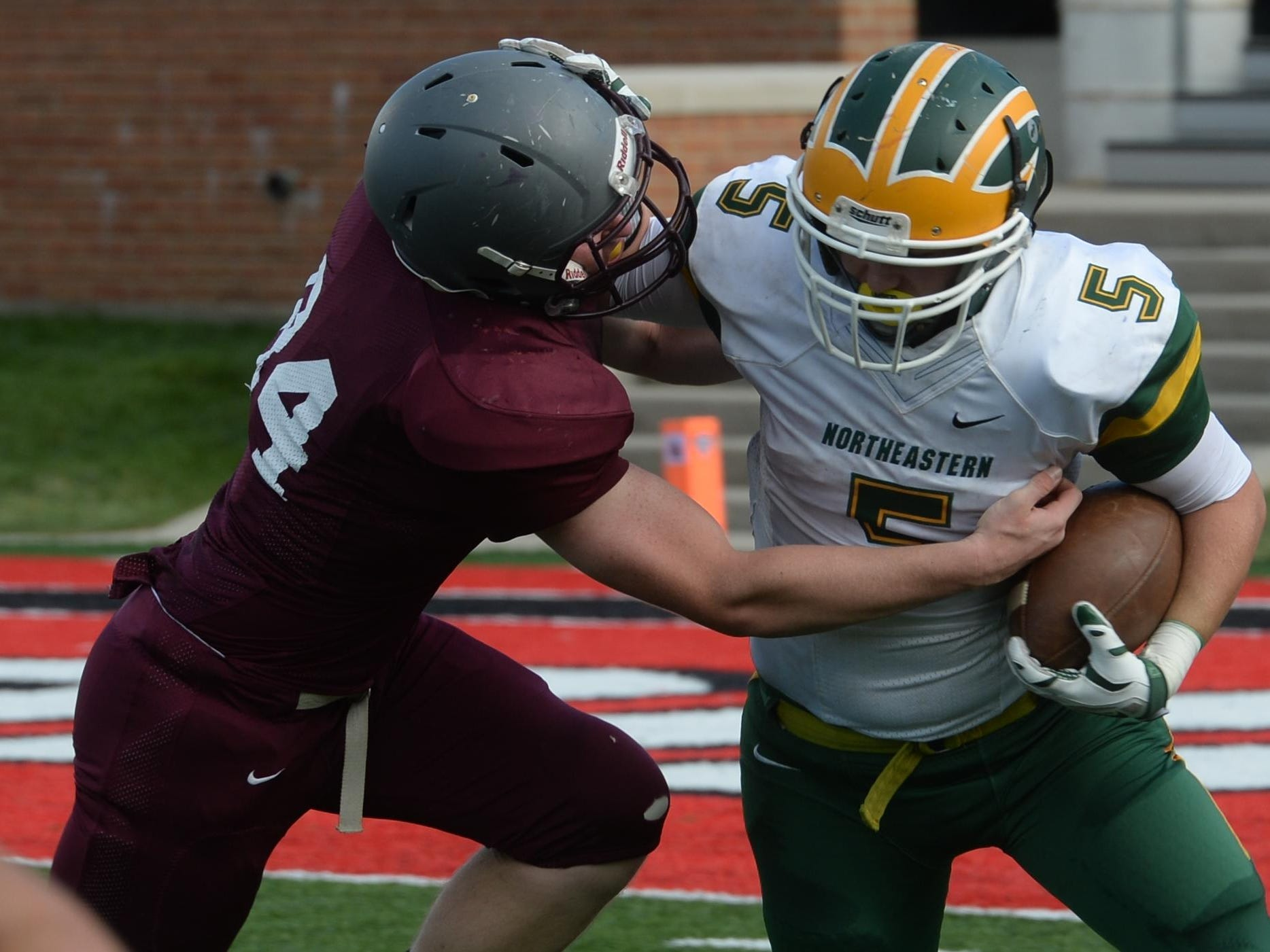 Northeastern's Connor Bray runs against Tri High last week. The Knights are 3-0 and atop the TEC standings.
