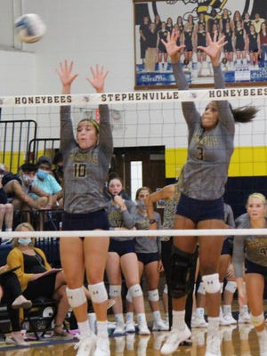 Stephenville High School's Jaylee Matthews (10) and Alee McClendon (3) are pictured competing in a recent home volleyball matchup. The second-ranked Honeybees improved to 11-0 Tuesday with a road win over Godley.