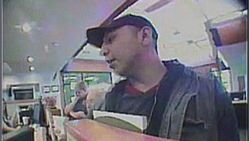 A screengrab from security video footage of the man who robbed a Wells Fargo Bank in Bloomington on May 8, 2018.
