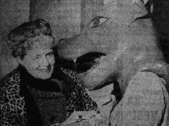 Marjorie Merriweather Post is greeted by a Battle Creek Central High School Bearcat.
