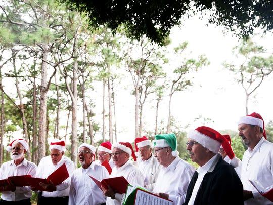 The Chorus of The Everglades, a barbershop chorus, performs during Preserving the Holiday Spirit at The Naples Preserve on Friday, Dec. 9, 2016.