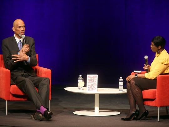 Political activist and NBA champion Kareem Abdul-Jabbar sits with Melissa Shivers, vice president for student life at the University of Iowa, as part of the University Lecture Committee series at Hancher Auditorium on Sunday, March 25, 2018.