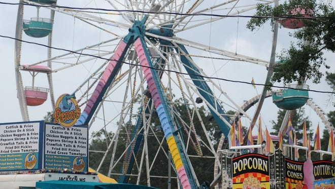 A Ferris wheel is seen on the midway at the 2011 Neshoba County Fair.