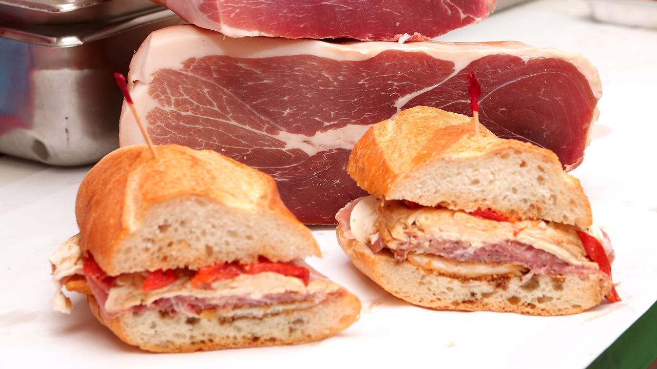 Owner Cosmo DePinto breaks down the chicken cutlet sandwich, with fresh prosciutto, at Cosmo's Italian Salumeria in Hackensack.