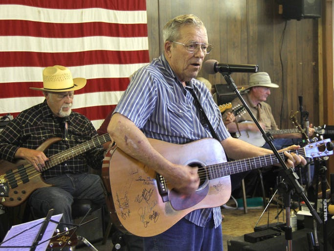 Don Taylor, who plays at many jams around the Ozarks, takes his turn to sing at the Northview Jam. Behind Taylor (from left) are John Jackson, Gary Dill and Kieth Baker.