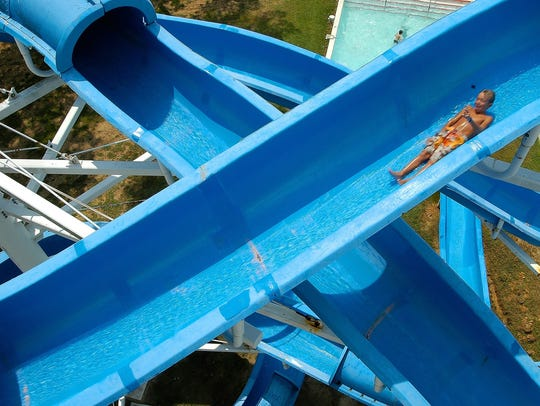 In 2005, Landry Lyle of Brandon speeds down the giant slide, one of the biggest draws at Rapids on the Reservoir, which closed following the summer of 2007.