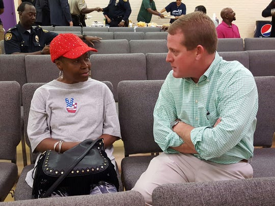 District 7 Councilman Arch Lee talks to Rosetta Moncrief at a town hall on March 28, 2017.