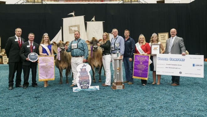 For the third consecutive year, Musqie Iatola Martha-ET (right) earned Grand Champion of the International Jersey Show at World Dairy Expo. The 6 year old is owned by Milksource Genetics, Kaukauna, WI. Reserve Senior and Reserve Grand Champion was the winning Five-Year-Old Cow, Elliotts Blackstone Charlotte-ET, owned by Rivendale Farms of Pittsburgh LLC, Bulger, PA.