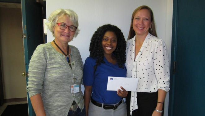 Joy Dixon presenting check to Escambia Community Clinics, Inc., for their partnership to increase colorectal screening rates for Community Health Center patients. (Left to right) Mary Ehrhardt, Director of Quality, Escambia Community Clinics Joy Dixon, Health Systems Manager, American Cancer Society Chandra Smiley, Executive Director, Escambia Community Clinics