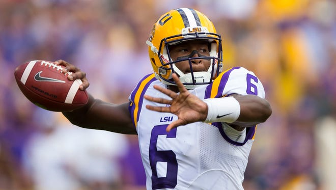 LSU Tigers quarterback Brandon Harris (6) throws a pass during the first quarter against the Wisconsin Badgers at Lambeau Field.   LSU lost 16-14.