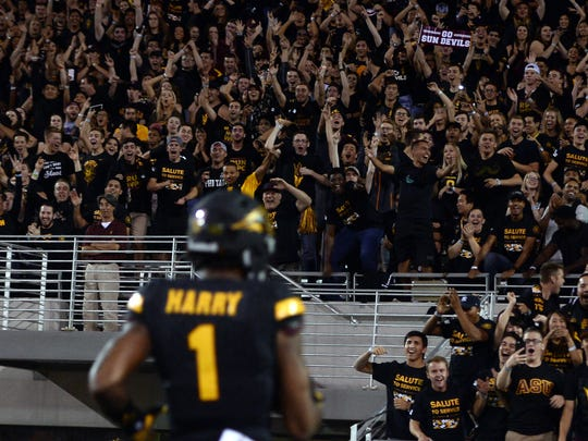 ASU fans cheer as N'Keal Harry scores a touchdown during a 2016 game against Utah.