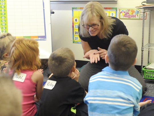 Silver Stage Elementary School first-grade teacher Audra Haines tells her students a story on the first day of school.