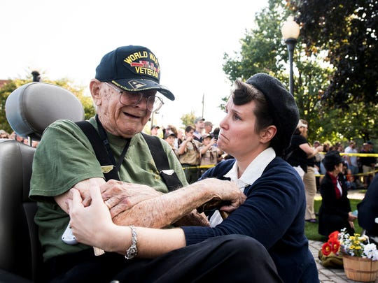 Amanda Charlton comforts Lawrence Bolin, 94, after he became emotional watching a World War II re-enactment battle in New Oxford on Saturday, Sept. 16, 2017. Bolin served as a private first class in the Army during World War II and landed on the beaches of Normandy on D-Day plus 6.