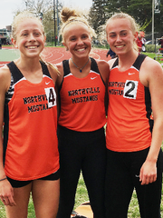 Northville's distance crew of (from left) Olivia Harp, Cayla Eckenroth and Ana Barrott made their presence known in the 1,600 and 3,200 races.