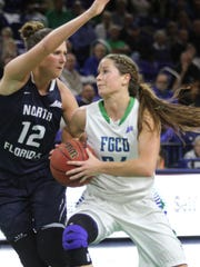 FGCU's Taylor Gradinjan attempts to get around North Florida's Paulina Zaveckaite during a Wednesday's game at Alico Arena. FGCU won 75-42 to improve to 15-2.