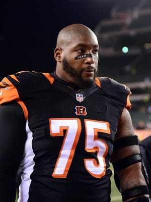 Nov 6, 2014; Cincinnati, OH, USA; Cincinnati Bengals defensive tackle Devon Still (75) walks off the field after the game against the Cleveland Browns at Paul Brown Stadium. Browns defeated the Bengals 24-3. Mandatory Credit: Andrew Weber-USA TODAY Sports ORG XMIT: USATSI-180280 ORIG FILE ID:  20141106_jla_aw3_301.jpg