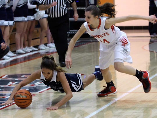 Jenni Harkcom of Central Catholic dives for a ball she tipped away from Maggie Deboy of Rossvile.
