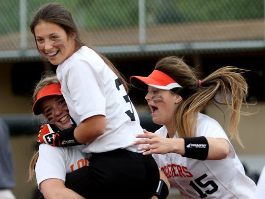 Scio's Olivia Zeiher (3) celebrates with teammate's after her game-winning home run in the Harrisburg vs. Scio softball game, in the quarterfinals of the OSAA Class 3A state playoffs, at Scio High School in Scio, Ore., on Friday, May 27, 2016. Scio won the game 10-0 in five innings.