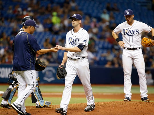 Rays pitcher Drew Smyly (33) is taken out of the game by manager Kevin Cash (16) during the seventh inning of the Tigers' win Friday.