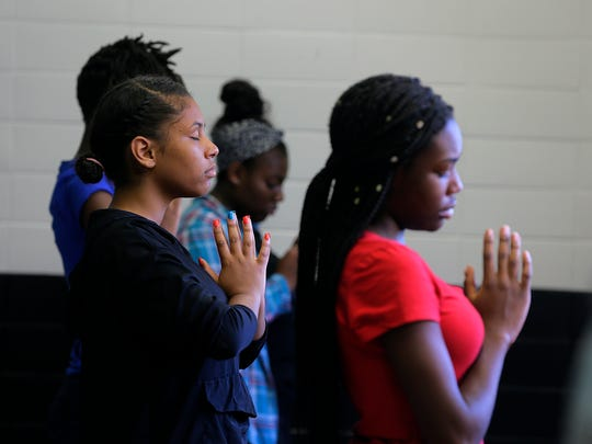 Dream Academy students participate in a yoga class taught by Amy Budinich of Root to Rise, a non-profit based in Asbury Park, at Asbury Park High School in Asbury Park, NJ Thursday September 22, 2016.