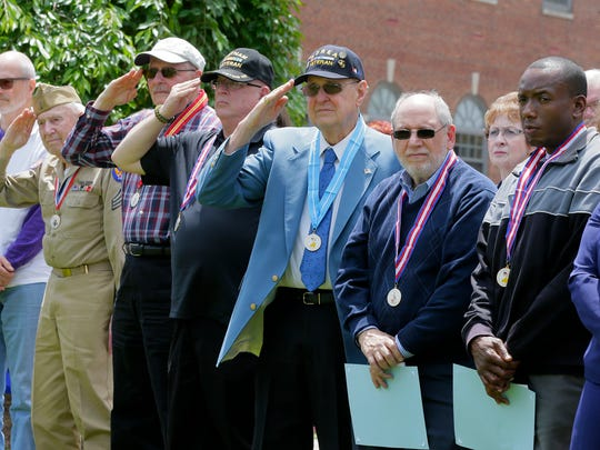 Recipients of the Distinguished Service Award medals attend the Morris County's Memorial Day ceremony for veterans on the lawn in front of the Morris County Courthouse in Morristown, NJ Wednesday May 24, 2017.