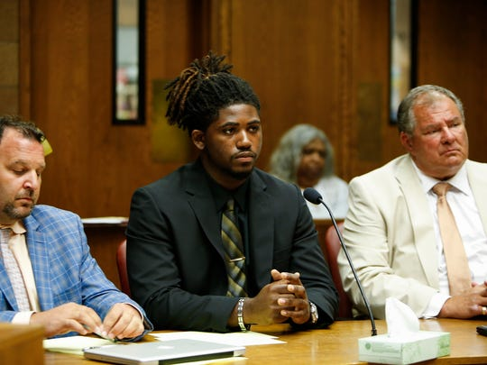 Flanked by attorneys Brent Leder, left, and David Rosenberg, former MSU football player Auston Robertson listens to 55th District Court  Judge Thomas Boyd   during his preliminary hearing on criminal sexual conduct charges Thursday, June 22, 2017.