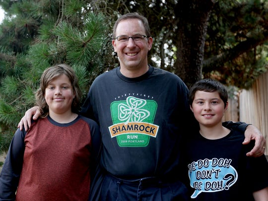 Patrick Thies, 48, and his sons Benjamin, 13, left,