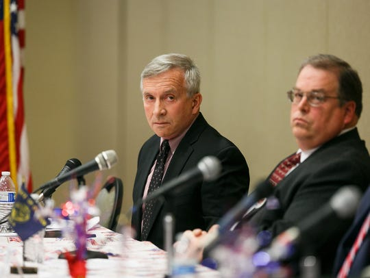 Republican gubernatorial candidate Sam Carpenter listens