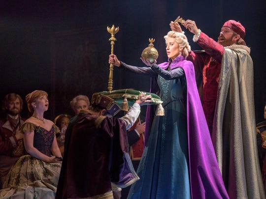"""Patti Murin, far left, as Anna, Caissie Levy as Elsa with Jacob Smith in a scene from """"Frozen"""" on Broadway."""