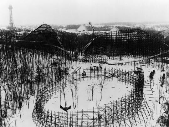 Aerial view of The Beast roller coaster at Kings Island while under construction in 1978/79. The Beast broke all existing records as the highest, fastest and longest wooden roller coaster in the world when it opened in 1979. It continues to hold the record as the longest wooden roller coaster in the world. This construction shot from the winter of 1978/79 shows the first hill at left in the background, with its 135-foot, 45-degree plunge into an underground tunnel. The second major hill is at the right. At the front of the photo is the helix.