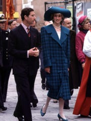 "FILE - In this May 5, 1985 file photo, Diana, Princess of Wales wears a blue tartan Emanuel suit during an official visit to Venice, Italy, with Britain's Prince Chalres. This outfit is featured in an exhibition of 25 dresses and outfits worn by Diana entitled ""Diana: Her Fashion Story"" at Kensington Palace in London, opening on Friday, Feb. 24, 2017."