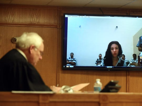 Anna Renae Runau, 18, of Gassville, appears via video before Baxter County Circuit Court Judge John Putman on Thursday. Her attorney entered a plea of not guilty to charges of criminal attempt to commit first-degree murder and aggravated robbery.