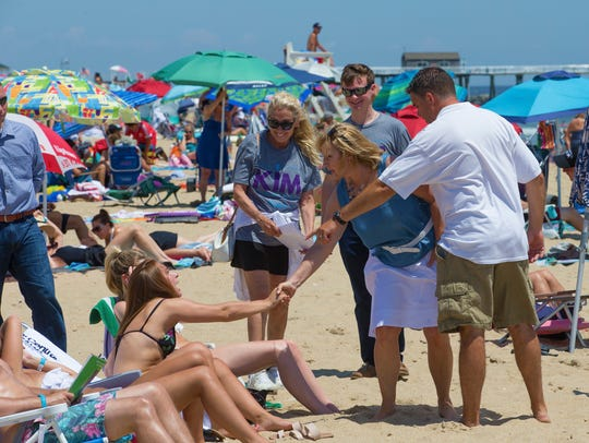 Lt. Governor Kim Guadagno shakes hands and talks with