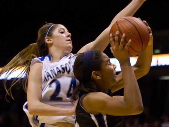 Manasquan's Katelynn Flaherty blocks a shot by Gill's