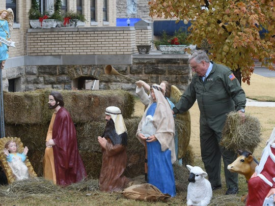 Mountain Home attorney Rick Spencer works Dec. 4 putting up a nativity scene on the Baxter County Courthouse lawn. After some controversy surrounding the nativity scene in 2013, the Baxter County Quorum Court passed a resolution allowing the religious display at the courthouse. A lawsuit challenging the nativity scene was subsquently filed.