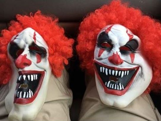 Clown masks used by two Troy-area high school students.