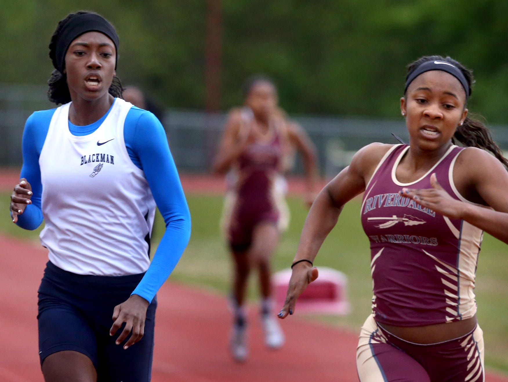 Riverdale's Anastasia Hayes, right stays ahead of Gabrielle Napper of Blackman to win the 400-meter Tuesday at Riverdale.