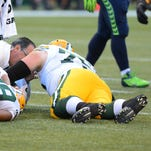 Packers right tackle Bryan Bulaga (75) was injured during Thursday night's game against the Seattle Seahawks at CenturyLink Field in Seattle.