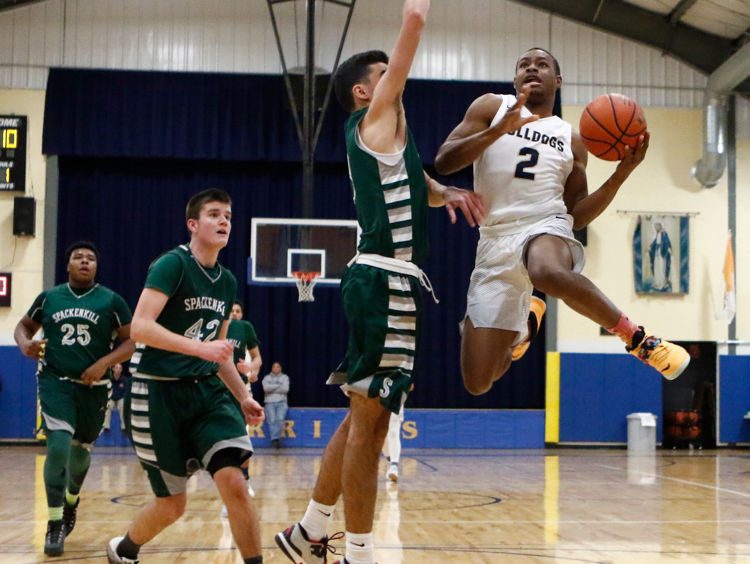 Beacon's Alex Bensen (3) drives against Spackenkill's Hayden Peek (3) left, in the championship game of the Duane Davis memorial basketball tournament at Our Lady of Lourdes High School in Poughkeepsie on Saturday, December 31, 2016.