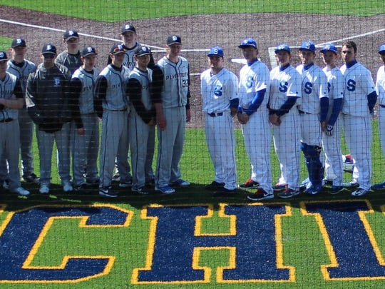 Plymouth and Salem players gather for a group photo following the opener of Saturday's doubleheader at University of Michigan's Ray Fisher Stadium.